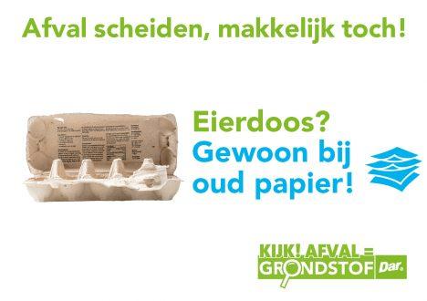 Eiersdoos bij oud papier en karton